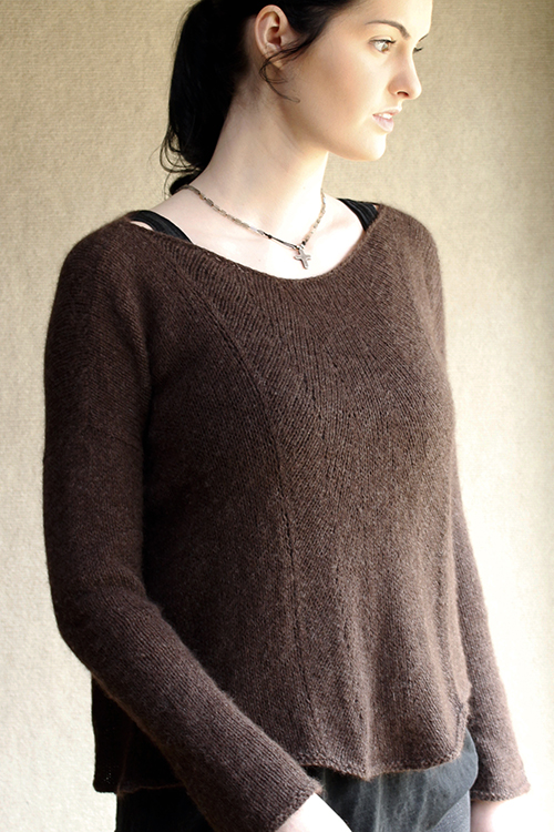 Unadorned sweater knitting pattern with pretty slant stitch pattern